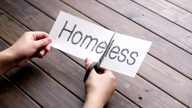 homeless to home by scissors on pattern wood plank