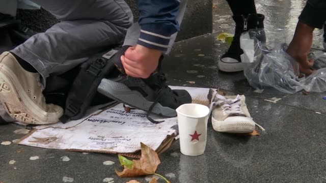 brixton man gives out shoes to london's homeless; england: london: brixton: ext various shots moosa nsubuga walking around brixton giving out shoes... - footwear stock videos & royalty-free footage