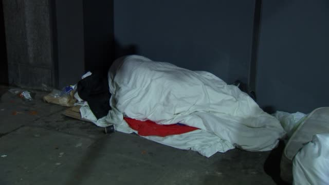 homeless people sleeping on london streets at night; england: london: ext at night various of homeless people sleeping rough on the streets at night - sleeping stock videos & royalty-free footage