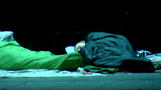 increasing number of rough sleepers in london; wide shot rough sleepers on pavement general views of homeless men lying in sleeping bags on pavement - sleeping stock videos & royalty-free footage