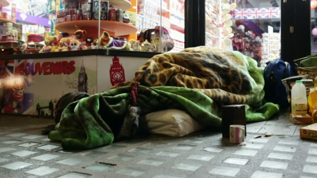 number of rough sleepers more than doubles in 8 years tx camden town homeless person sleeping in shop doorway homeless man seated on pavement outside... - tramp stock videos & royalty-free footage