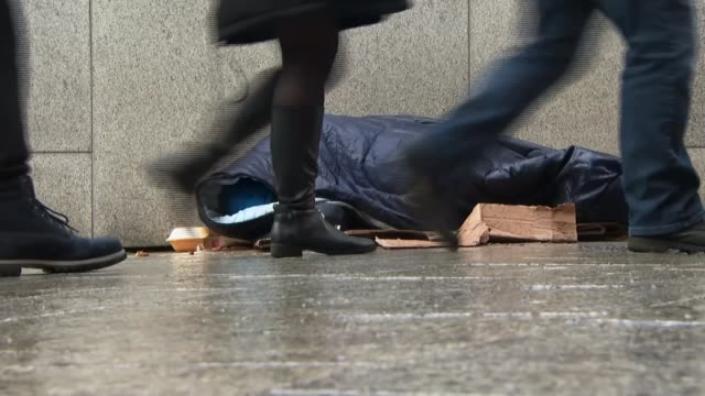 plight of 'hidden' rough sleepers tx england birmingham ext homeless person lies in sleeping bag on pavement with passing pedestrians - homelessness stock videos & royalty-free footage
