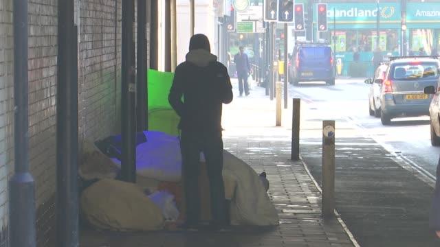 rough sleepers under finsbury park bridge; england: london: finsbury park: ext various shots of tents and mattresses under bridge near finsbury park... - homelessness stock videos & royalty-free footage