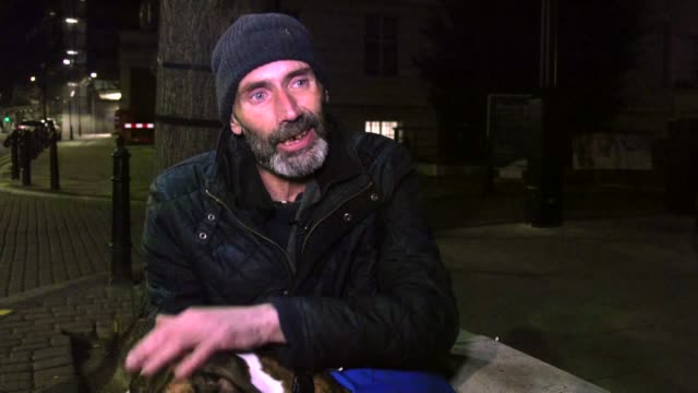 Street Vets offers support service to dogs of the homeless ENGLAND London Bailey the dog of homeless man Andy Hutchins carrying a bag of dog food in...