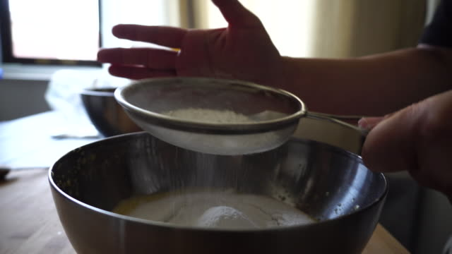 homemade biscuit: sifting flour powder - flour stock videos & royalty-free footage