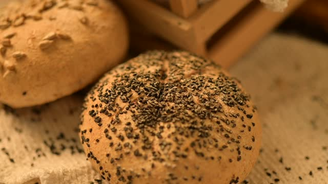 homemade bread on a rustic background. fresh bakery. slow motion video - wood grain stock videos & royalty-free footage