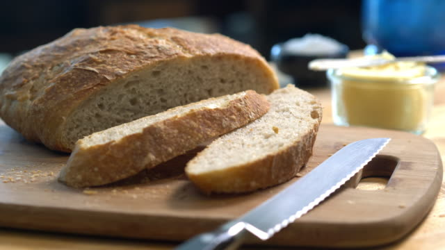 homemade bread warm right from the oven - pane a lievito naturale video stock e b–roll