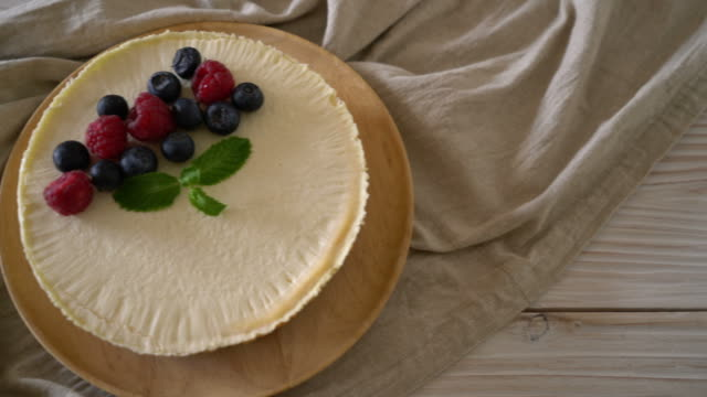 Homemade cheesecake with fresh raspberries and blueberries