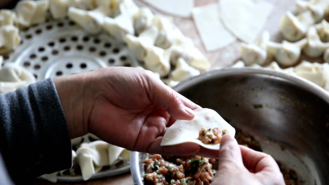 homemade cooking chinese ravioli (huntun yuntun wonton) - pinching stock videos & royalty-free footage