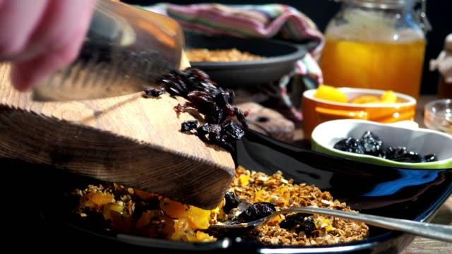 homemade granola preparing - raisin stock videos and b-roll footage