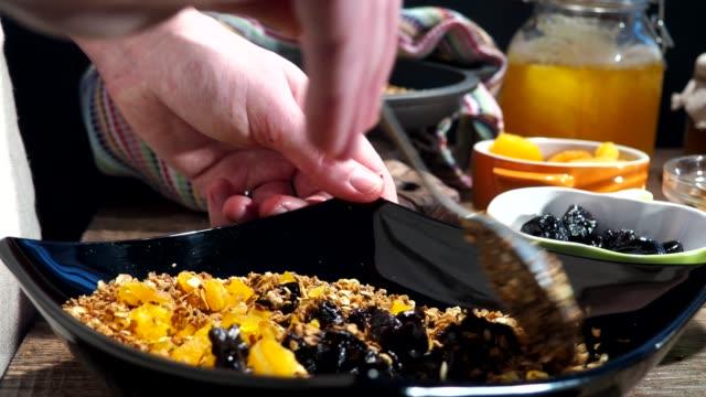 homemade granola preparing - recipe stock videos & royalty-free footage