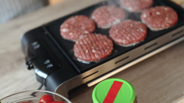 homemade hamburgers on electric grill - electrical equipment stock videos & royalty-free footage