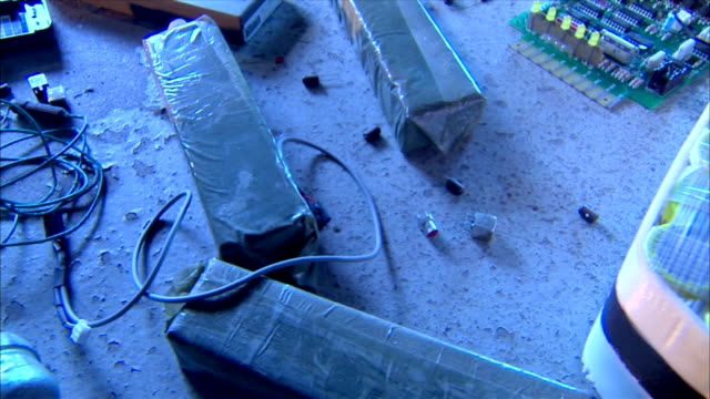 Homemade improvised explosive devices clutter a floor in Boston.