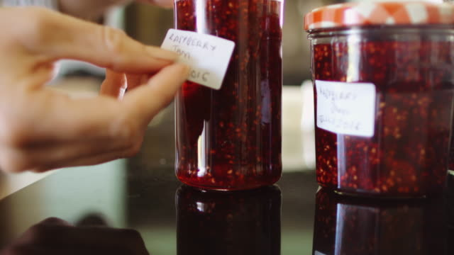 homemade jam being labelled - preserve stock videos and b-roll footage