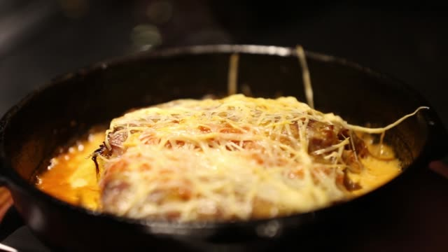 homemade lasagna covered with shredder cheese - gratin stock videos & royalty-free footage