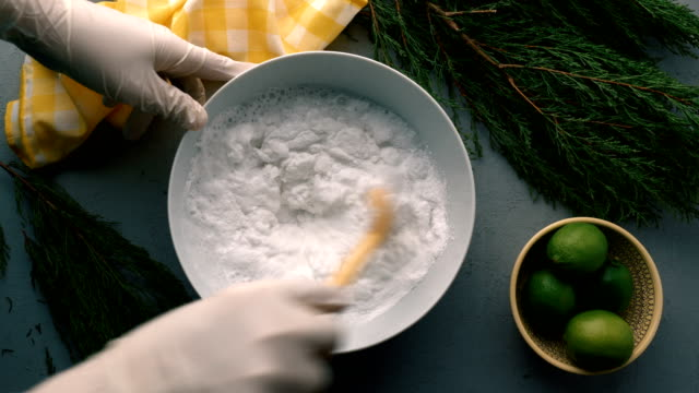 homemade natural dishwashing detergent and diy  tabs - mixing with wooden spoon - ecosystem stock videos & royalty-free footage