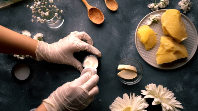 diy - homemade natural hand cream making - after work cleaning the glass jar - manufactured object stock videos & royalty-free footage