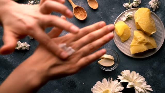 diy - homemade natural hand cream making - applying hand cream - skin care stock videos & royalty-free footage