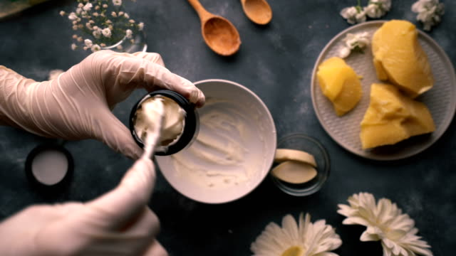 diy - homemade natural hand cream making - filling the glass jar with cream - raw food stock videos & royalty-free footage