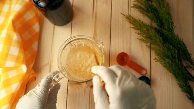 diy - homemade organic stain remover spray making - mixing ingredients - spray cleaner stock videos & royalty-free footage