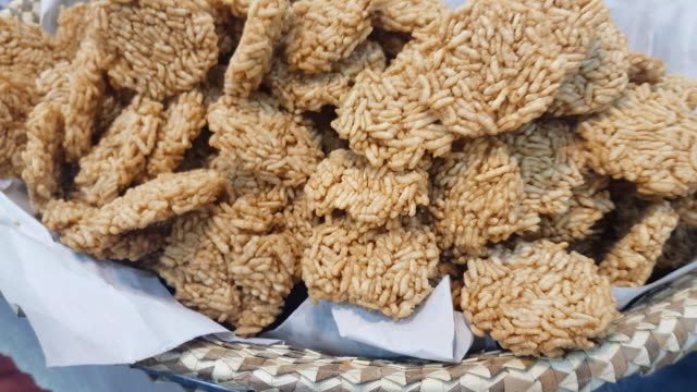 homemade rice crispy ,thai sweet crispy rice cracker isolated on white background. - cracker stock videos and b-roll footage