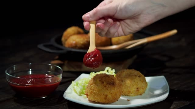 homemade vegan arancini (risotto balls) - croquette stock videos and b-roll footage