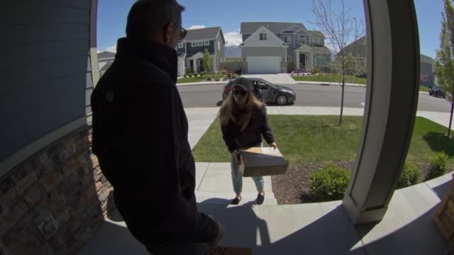 homeowner catching thief trying to steal package from front stoop / lehi, utah, united states - lehi stock videos & royalty-free footage