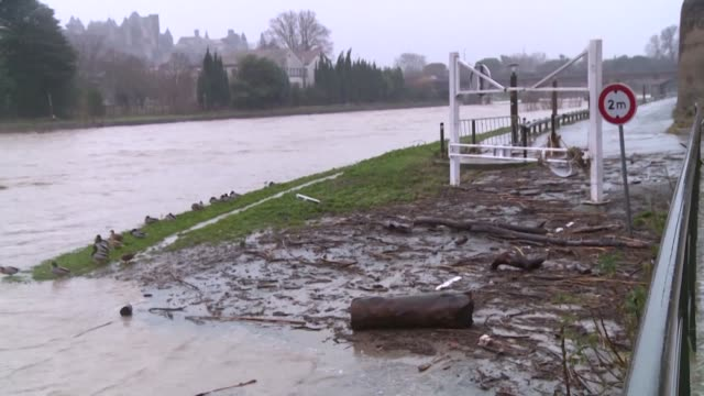 homeowners in carcassonne's palais district survey the damage after the river aude burst its banks on wednesday night - aude stock videos & royalty-free footage