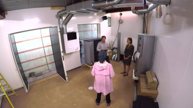homeowners offered government help to pay for energy-saving improvements; england: devon: ext nick moffat and kye moffat chatting with reporter gvs... - energy efficient stock videos & royalty-free footage