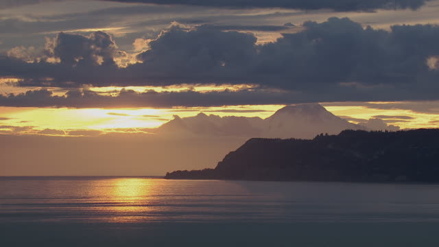 homer alaska promontory and mountain at dusk - homer alaska stock videos & royalty-free footage