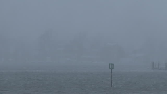 Homes along the shore are barely visible as heavy snow and strong winds create near whiteout conditions in Manasquan NJ during the historic Blizzard...