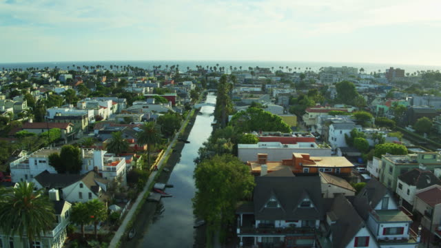 homes among canals in venice, california - aerial shot - canal stock videos & royalty-free footage
