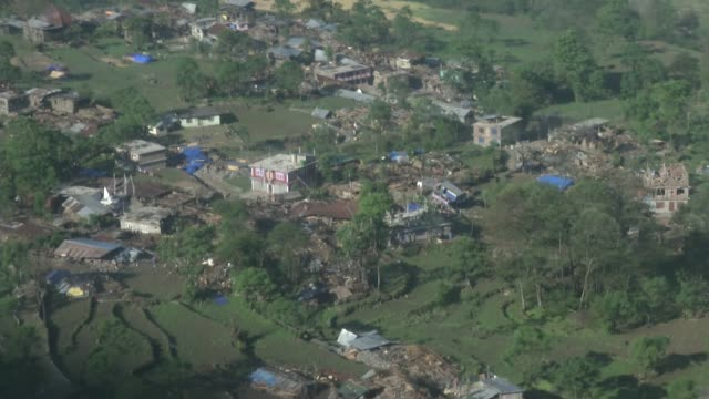 homes and building are destroyed as viewed from a helicopter in the chautara region / a major earthquake hit kathmandu mid-day on saturday, april... - nepal stock videos & royalty-free footage