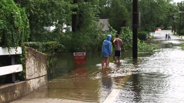 homes and streets flooded by hurricane irene in new milford, new jersey / vehicle unable to pass as a result of flooding aftermath of hurricane irene... - hurricane irene stock videos & royalty-free footage
