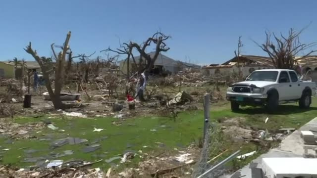 homes are left with no roofs and debris litter the ground after hurricane dorian ripped across great abaco island in the bahamas - bahamas stock videos & royalty-free footage