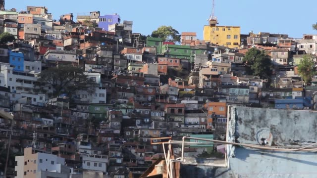 homes are stacked on a hillside in the rocinha favela in rio de janeiro brazil on thursday aug 20 2015 shots of wide shot and close up views of... - oscar niemeyer stock videos and b-roll footage
