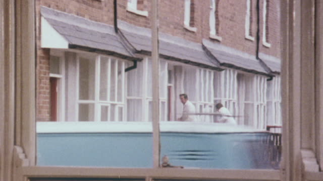 1980 MONTAGE Homes being remodeled by workmen and rooms of homes after being modernized / United Kingdom