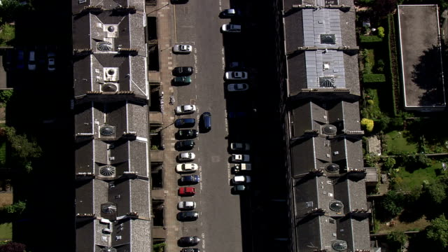 Homes line the streets in a residential neighborhood in Scotland. Available in HD.