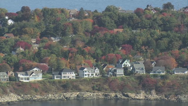 aerial homes lining the coastline, surrounded by autumn foliage / york beach, maine, united states - maine stock videos & royalty-free footage