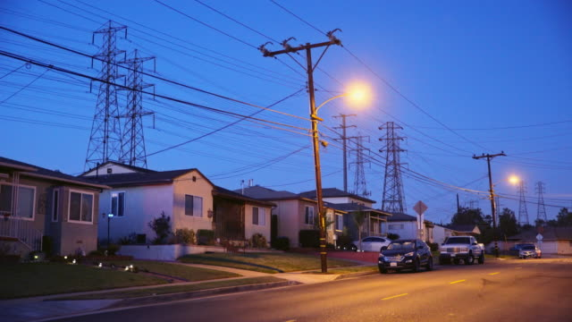 Homes with Power Lines - Night