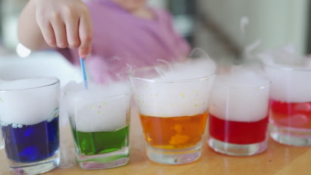 homeschooling, little boy learning science with dry ice at home. - science and technology stock videos & royalty-free footage