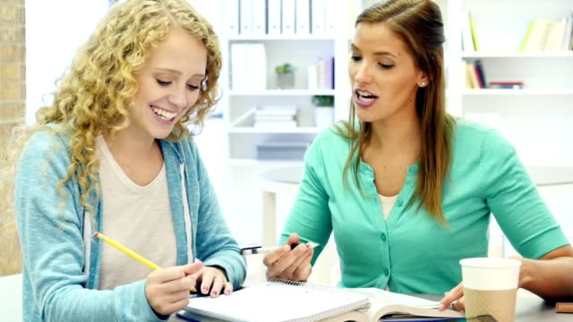 Homeschooling mom encourages daughter during assignment