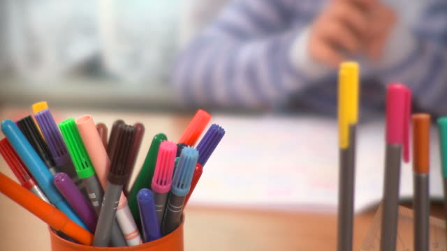 hd: homework - pen holder stock videos & royalty-free footage