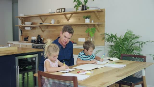 homework - 45 49 år bildbanksvideor och videomaterial från bakom kulisserna