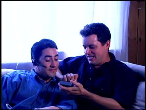 stockvideo's en b-roll-footage met homosexual couple using pda - elektronische organiser