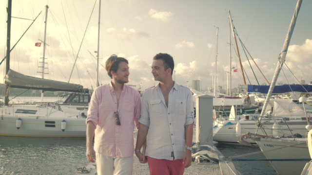 Homosexual Couple Walking at the Marina