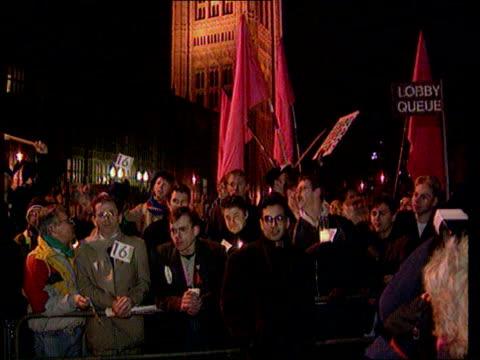 vídeos y material grabado en eventos de stock de homosexuality age of consent vote lib london westminster night gay rights protesters protesting outside parliament - aprobado