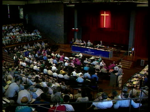 homosexuality age of consent vote; lib london: the general synod: tgv general synod meeting in progress bishops seated - synod stock videos & royalty-free footage