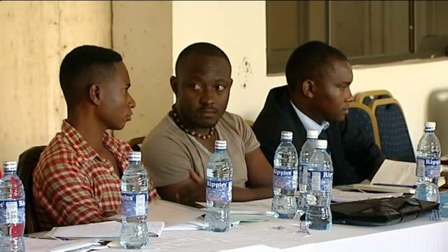 british theatre producer goes on trial over 'gay play'; kampala: int gay rights activists seated at meeting ext geoff ogwaro interview sot - kampala stock videos & royalty-free footage