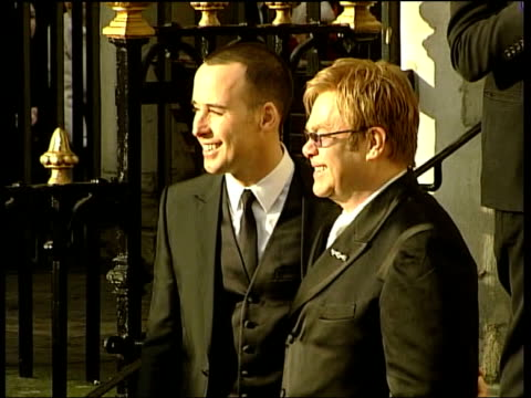 Civil Partnerships Sir Elton John 'marries' i/c Elton John and David Furnish waving to crowd GV Elton John and David Furnish posing for fans and...